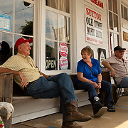 Stan Webster, left, talks with Dara and Louie Kell on the porch of the T.B. Sutton Store in Historic Granville, Tennessee. Nathan Lambrecht/Journal Communications
