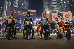 October 31, 2018 - Kuala Lumpur, Malaysia - From left Malaysian MotoGP rider Hafizh Syahrin of Monster Yamaha Tech 3, Malaysian Moto3 rider Adam Norrodin of SIC Racing Team, Japanese Moto3 rider Ayumu Sasaki of SIC Racing Team and Malaysian Moto2 rider Khairul Idham Pawi of Idemitsu Honda Team Asia pose with their bikes in front of the Malaysia's landmark Kuala Lumpur twin tower in Kuala Lumpur, during a MotoGP pre-event ahead of Malaysian Grand Prix, on October 31, 2018. (Credit Image: © Zahim Mohd/NurPhoto via ZUMA Press)