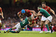 Justin Tipuric of Wales © is tackled by Ireland's Paddy Jackson (10).  Wales v Ireland rugby union international, RWC warm up friendly match at the Millennium Stadium in Cardiff, South Wales on Saturday 8th August  2015.<br /> pic by Andrew Orchard, Andrew Orchard sports photography.