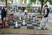 03 AUGUST 2007 -- BERN, SWITZERLAND: Men play chess on a plaza in Bern, the federal capital of Switzerland. The city was founded in the 12th century by Berchtold V, Duke of Zahringen, who established a fort on the site of the present day city. Because of its well maintained downtown core, preserved arcades and fountains, Bern is a UNESCO World Heritage Site. Photo by Jack Kurtz/ZUMA Press