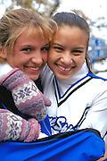 Happy cheerleaders participating in Anoka Halloween Festival Parade age 17.  Anoka Minnesota USA