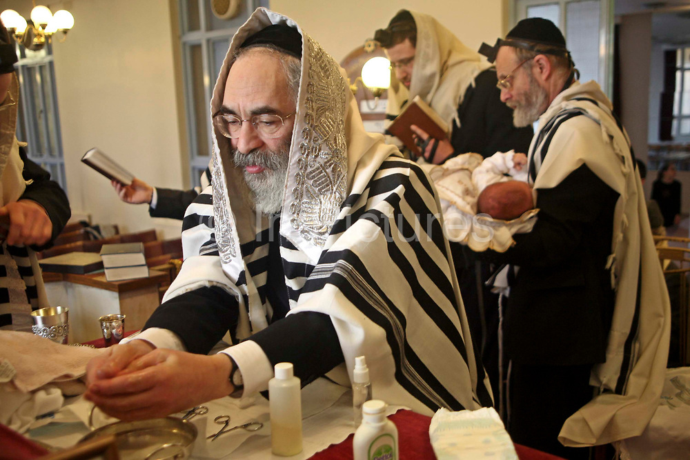 The Mohel washes his hands before the circumcision ceremony begins. On the 8th day after birth a Brit Milah (Circumcision) is performed on a Jewish baby boy (unless there is a medical reason to delay it). The ceremony takes place in the synagogue and the man who carries out the skin removal is know as a Mohel and is medically trained, the boy is also given his Hebrew and/or English names.