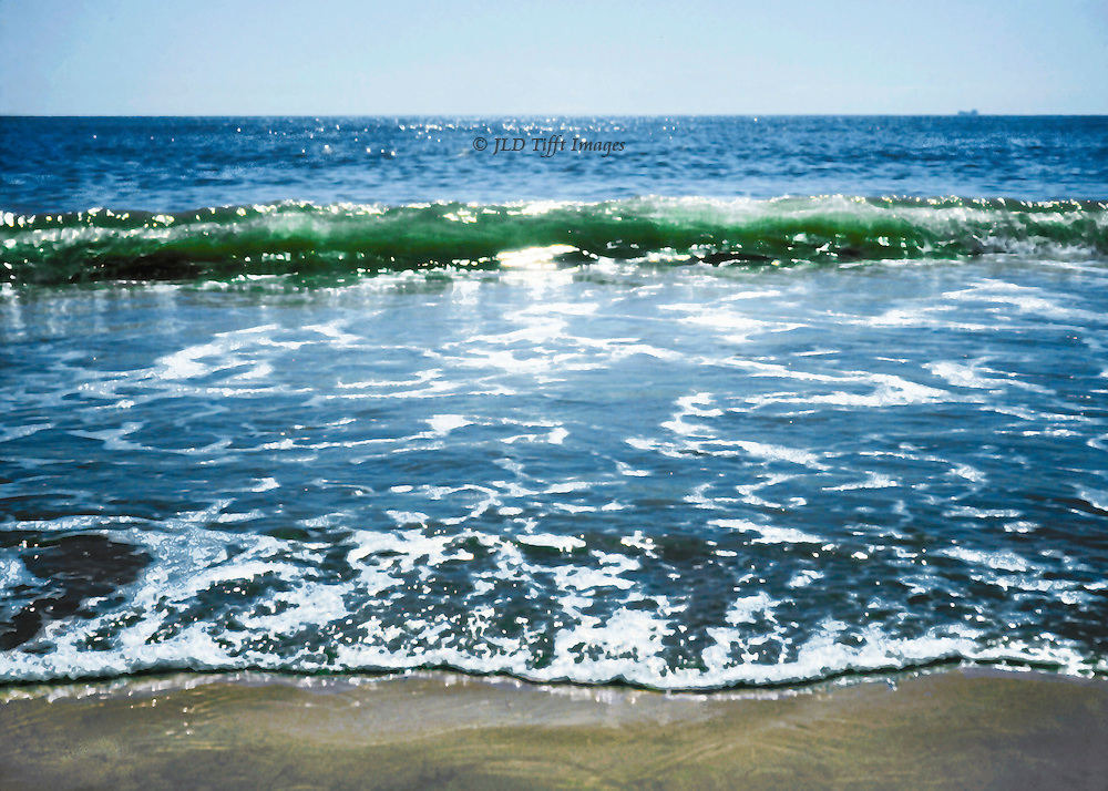 Gentle surf of the Atlantic Ocean at Virginia Beach, lapping onto the sandy beach.  Foam in the shallows glitters in the bright sunlight.  Postprocessed painterly effect.