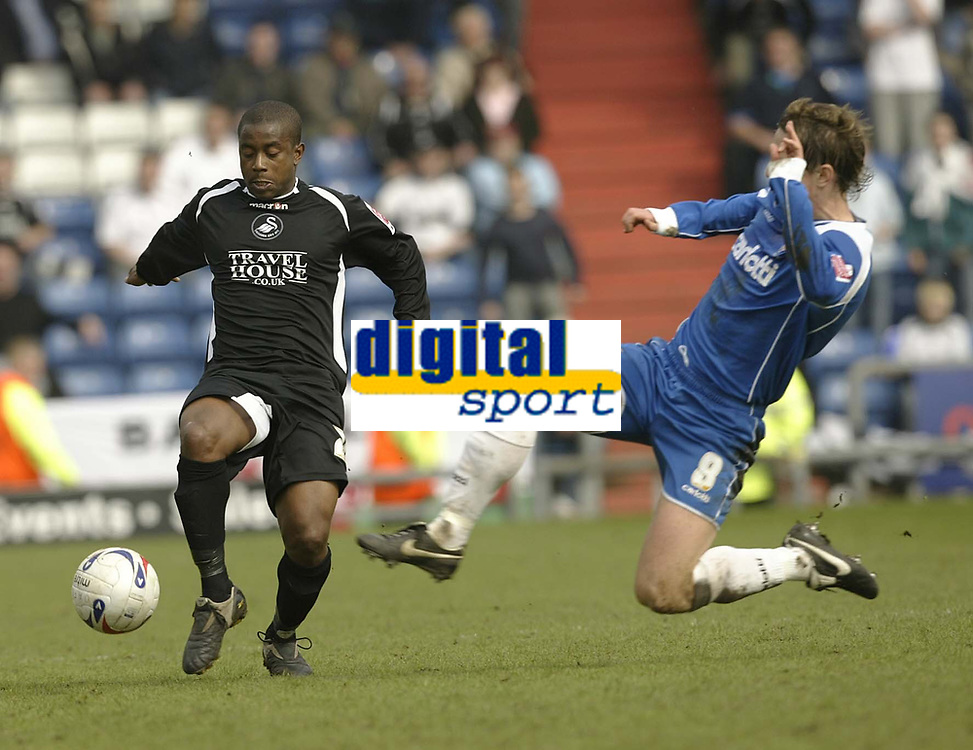 Photo: Aidan Ellis.<br /> Oldham Athletic v Swansea City. Coca Cola League 1. 22/04/2006.<br /> Oldham's Mark Hughes nips in to win the ball from Swansea's Leon Knight