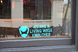 Living Wage Employer sign in window of Brewdog bar, Norwich April 2016
