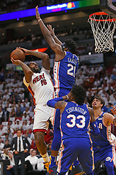 April 19, 2018 - Miami, FL, USA - The Miami Heat's James Johnson goes to the basket against the Philadelphia 76ers' Joel Embiid during the first quarter in Game 3 of a first-round NBA playoff series at AmericanAirlines Arena in Miami on Thursday, April 19, 2018. (Credit Image: © David Santiago/TNS via ZUMA Wire)