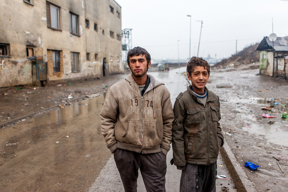 """Portrait of two young residents at the Roma settlement located at """"Budulovska Street"""" in Moldava nad Bodvou about 30 km from Kosice. In 2015 the """"muddy"""" roads to and in the settlement were asphalted and the infrastructure for the residents  improved. From about 800 inhabitants of the segregated settlement 'Budulovska Street' (2014) are roughly 392 children up to the age of 16 years."""