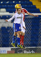 Bury's Danny Rose goes up for a header with Barnsley's Marc Roberts<br /> <br /> Photographer Richard Martin-Roberts/CameraSport<br /> <br /> Football - The Football League Sky Bet League One - Bury v Barnsley - Tuesday 23rd February 2016 - Gigg Lane - Bury  <br /> <br /> © CameraSport - 43 Linden Ave. Countesthorpe. Leicester. England. LE8 5PG - Tel: +44 (0) 116 277 4147 - admin@camerasport.com - www.camerasport.com