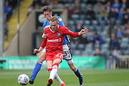 Joe Bunney challenges Liam Nash during the EFL Sky Bet League 1 match between Rochdale and Gillingham at Spotland, Rochdale, England on 23 September 2017. Photo by Daniel Youngs.