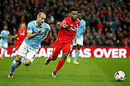 Pablo Zabaleta of Manchester City (l) and Daniel Sturridge of Liverpool chase the ball. Capital One Cup Final, Liverpool v Manchester City at Wembley stadium in London, England on Sunday 28th Feb 2016. pic by Chris Stading, Andrew Orchard sports photography.