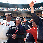 June 27 2021 San Francisco CA, U.S.A. Bay Area recording artist and producer E-40, his wife and Giants President Larry Baer hanging with the fan during the MLB game between the Oakland Athletics and the San Francisco Giants at Oracle Park San Francisco Calif. Thurman James / CSM