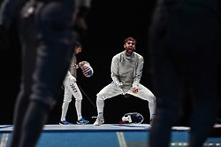 WUXI, July 27, 2018  Daniele Garozzo (C) of Italy reacts during the men's foil team final between Italy and the United States at the Fencing World Championships in Wuxi, east China's Jiangsu Province, July 27, 2018. Italy beat US 45-34 and claimed the title of the event. (Credit Image: © Li Bo/Xinhua via ZUMA Wire)