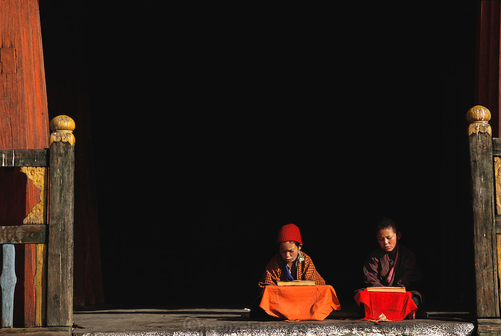 Young Buddhist monks read holy scripts aloud at the Gangte Goemba (monastery) in Phobjikha Valley, Bhutan. The monastery dates back to the 1600's and includes one of the largest prayer halls in the country and a meditation center for monks. The government financed the building of a Buddhist college here in the 1980's.