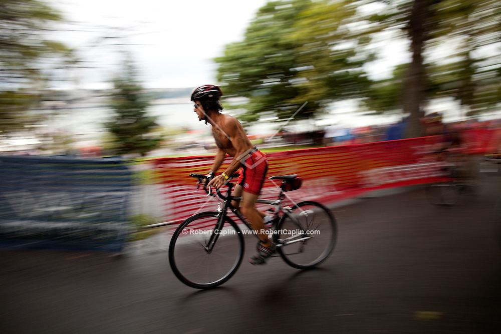 Triathletes exit the Hudson River and enter the biking phase of New York City Triathlon...Photo by Robert Caplin.