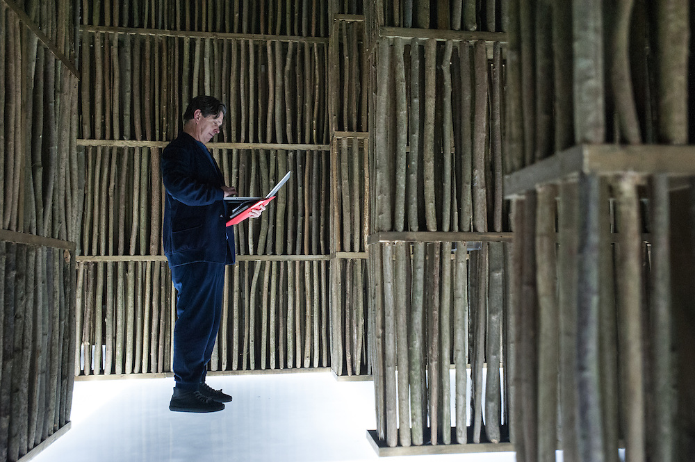 London, UK - 21 January 2014: a man works on his laptop inside the installation by Li Xiaodong at the Sensing Spaces: Architecture Reimagined exhibition at the Royal Academy of Arts
