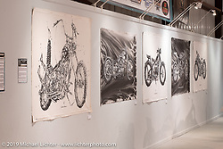 Motorcycle artist Makoto Endo's paintings on display in the What's the Skinny Exhibition (2019 iteration of the Motorcycles as Art annual series) at the Sturgis Buffalo Chip during the Sturgis Black Hills Motorcycle Rally. SD, USA. Friday, August 9, 2019. Photography ©2019 Michael Lichter.