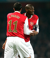 Photo: Tom Dulat/Sportsbeat Images.<br /> <br /> Arsenal v Steaua Bucharest. UEFA Champions League. 12/12/2007.<br /> <br />  Arsenal's Abou Diaby (R) and Robin van Persie (L) celebrate Diaby's opener. Arsenal leads 1-0