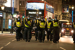 © Licensed to London News Pictures. 05/11/2020. London, UK. Police gather in central during the Million Mask March demonstration. On the first day of Britain's second lockdown. Photo credit: Marcin Nowak/LNP