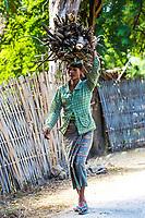 CHAUNG-U, MYANMAR - DECEMBER 01, 2016 : burmesse farmer woman walking on the road near Monywa
