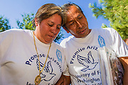 25 JUNE 2012 - PHOENIX, AZ: PATRICIA ROSAS, left, and GUSTAVO CRUZ, pray after the US Supreme Court ruled on US v. Arizona and Arizona's SB1070 at the Arizona State Capitol in Phoenix, AZ, Monday. The lawsuit, US v. Arizona, determines whether or not Arizona's tough anti-immigration law, popularly known as SB1070 is constitutional. Among other things, the law requires police officers to check the immigration status of anyone whom they arrest, allows police to stop and arrest anyone whom they believe to be an illegal immigrant, makes it a crime for someone to be in the state without valid immigration papers, and makes it a crime to apply for or hold a job in Arizona without proper papers. The federal government sued Arizona because it believes the law is invalid because it is trumped by federal immigration laws. The court struck down most of the law but left one section standing, the section authorizing local police agencies to check the immigration status of people they come into contact with.   PHOTO BY JACK KURTZ