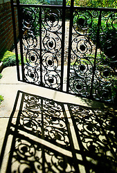 Iron gate and shadows at Serge Hill