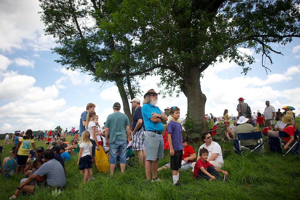 Spectators linger under a shade tree after the first battle of the four day Gettysburg Anniversary Committee 150th Gettysburg reenactment called 'The Devil's to Pay' in Gettysburg, PA on July 4, 2013.