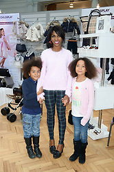 SINITTA and her children with her children MAGDALENA and ZAC at the Plusher Fair, Lindley Hall, Royal Horticultural Halls, Vincent Square, London, on 9th November 2013.