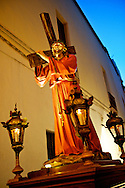 A statue of Christ bearing the cross walked on one of Gallipoli's narrow streets