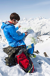 Man cross-country skier Alps reading map