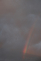 Cloudy sky with rainbow