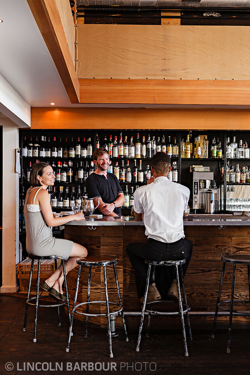 Patrons enjoy a drink at Clyde Common's bar