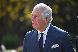 EMBARGOED TO 1100 THURSDAY APRIL 15 The Prince of Wales visits the gardens of Marlborough House, London, to view the flowers and messages left by members of the public outside Buckingham Palace following the death of the Duke of Edinburgh on April 10. Picture date: Thursday April 15, 2021.