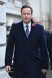 Former Prime Minister David Cameron walks through Downing Street on his way to the annual Remembrance Sunday Service at the Cenotaph memorial in Whitehall, central London, held in tribute for members of the armed forces who have died in major conflicts.