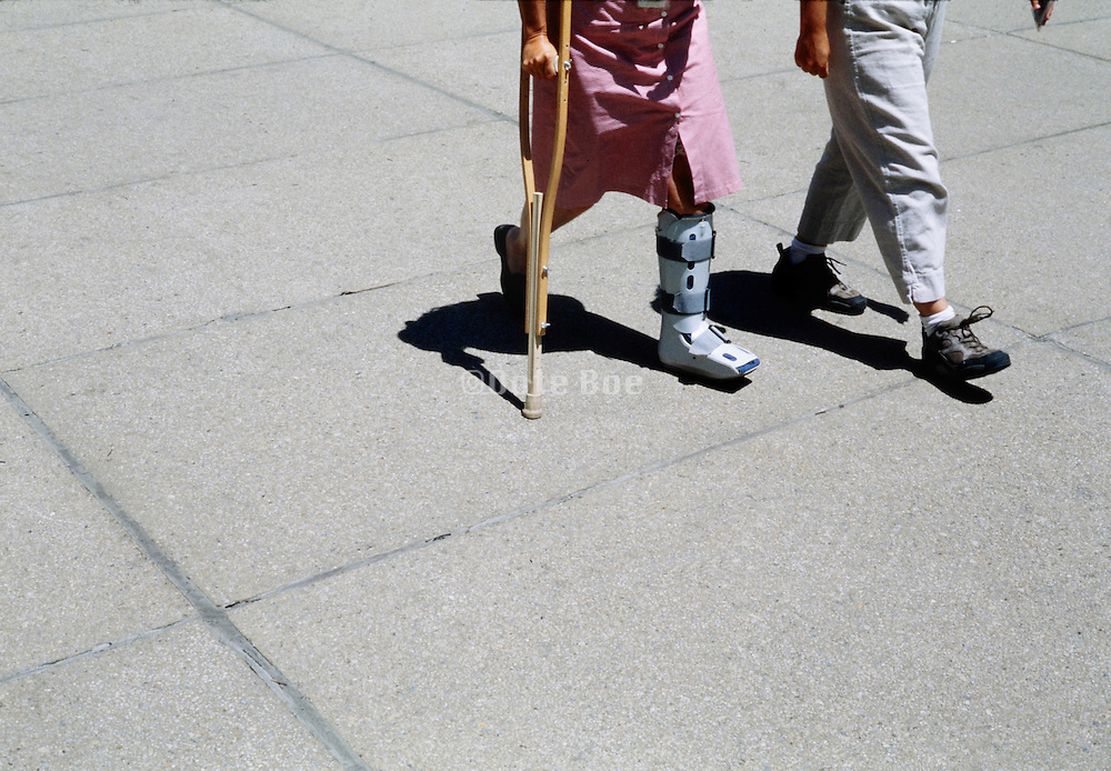 female person with cast and crutches