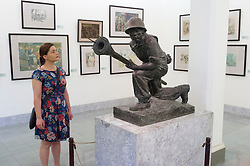 Woman looking at Revolutionary sculpture in Vietnam Museum of Fine Arts in Hanoi