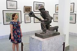 Woman looking at Revolutionary sculpture in Vietnam Museum of Fine Arts in Hanoi