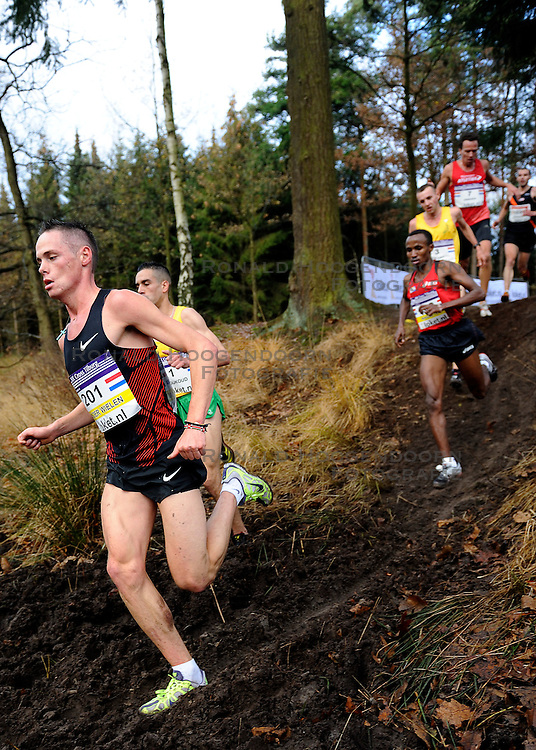 27-11-2011 ATLETIEK: NK CROSS 53e WARANDELOOP: TILBURG<br /> Khalid Choukoud die zijn cross-titel prolongeerde in 30:42. Rechts Abdi Nageeye (U23) AA Drink en links Jesper van der Wielen (U23)<br /> ©2011-FotoHoogendoorn.nl