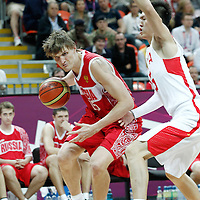 31 July 2012: Russia Andrei Kirilenko drives past China Peng Zhou during the 73-54 Russia victory over China, during the men's basketball preliminary, at the Basketball Arena, in London, Great Britain.