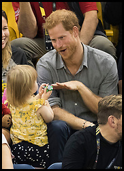 September 28, 2017 - Toronto, London, Canada - Image licensed to i-Images Picture Agency. 27/09/2017. Toronto, Canada. Prince Harry  with Emily Henson, the daughter of his wounded serviceman friend Dave Henson  as they watch the sitting volleyball competition  on day five of the  Invictus Games in Toronto, Canada.  Picture by Stephen Lock / i-Images (Credit Image: © Stephen Lock/i-Images via ZUMA Press)