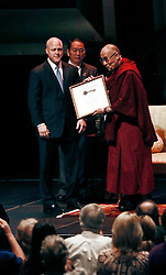 17 May 2013. New Orleans, Louisiana,  USA..New Orleans mayor Mitch Landrieu hand over a key to the city to the Dalai Lama  at the Morial Convention Center. His Holiness the 14th Dalai Lama is in New Orleans for the 'Resiliance - Strength through Compassion and Connection' conference. .Photo; Charlie Varley.