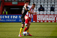 Bobby Thomas of Barrow and Luke Norris of Stevenage tackle for the ball during the EFL Sky Bet League 2 match between Stevenage and Barrow at the Lamex Stadium, Stevenage, England on 27 March 2021.