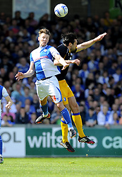 Bristol Rovers' Ollie Clarke battles for the high ball with Mansfields Martin Riley - Photo mandatory by-line: Joe Meredith/JMP - Mobile: 07966 386802 03/05/2014 - SPORT - FOOTBALL - Bristol - Memorial Stadium - Bristol Rovers v Mansfield - Sky Bet League Two