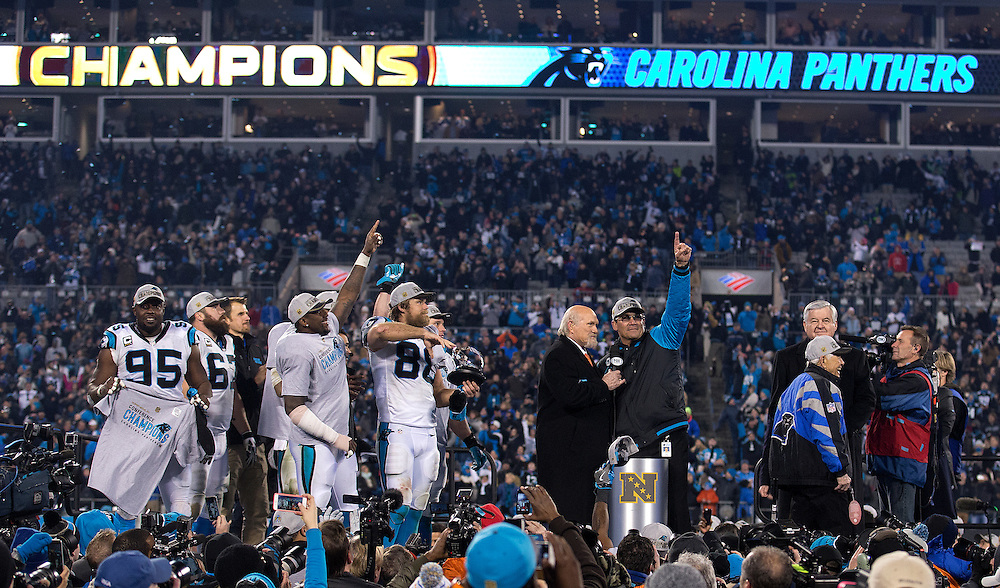 CHARLOTTE, NC - JAN 24:  Members of the Carolina Panthers celebrate after the NFC Championship game against the Arizona Cardinals at Bank of America Stadium on January 24, 2016 in Charlotte, North Carolina.