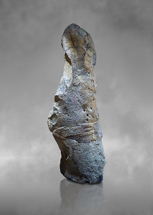 Late European Neolithic prehistoric Menhir standing stone with carvings on its face side. The remains of a representation of a stylalised male figure starts at the top with a long nose from which 2 eyebrows arch around the top of the stone. below this is a carving of a falling figure with head at the bottom and 2 curved arms encircling a body above. at the bottom is a carving of a dagger running horizontally across the menhir. the bottom is a carving of a dagger running horizontally across the menhir. Excavated from Piscina 'E Sali IV site,  Laconi.  Menhir Museum, Museo della Statuaria Prehistorica in Sardegna, Museum of Prehoistoric Sardinian Statues, Palazzo Aymerich, Laconi, Sardinia, Italy .<br /> <br /> Visit our PREHISTORIC PLACES PHOTO COLLECTIONS for more photos to download or buy as prints https://funkystock.photoshelter.com/gallery-collection/Prehistoric-Neolithic-Sites-Art-Artefacts-Pictures-Photos/C0000tfxw63zrUT4