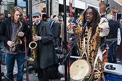 London, UK. 9th February, 2019. Musicians entertain activists from Extinction Rebellion blocking Kingsland Road in Dalston as part of a 'Saturday street party' intended as a means of engagement around climate change and environmental issues with the local community.
