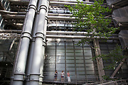 Visitors to the City of London walk around the Lloyds Building. UK. The Lloyd's building, sometimes known as the Inside-Out Building. is the home of the insurance institution Lloyd's of London. It is located on the former site of East India House in Lime Street, in London's main financial district.