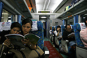 China, Hong Kong, Passengers aboard the train from the airport to the city.