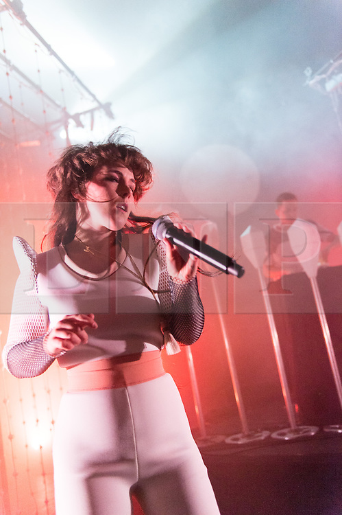 © Licensed to London News Pictures. 30/04/2015. London, UK.   Purity Ring performing live at Shepherds Bush Empire.  In this picture - Megan James (left), Corin Roddick (right).  Purity Ring are a Canadian electronic music duo originally from Edmonton, Alberta formed in 2010.The band consists of Megan James (vocals) and Corin Roddick (instrumentals). Photo credit : Richard Isaac/LNP