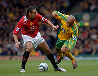 Photo. Glyn Thomas, dIGITALSPORT<br /> Norwich City v Manchester United.<br /> Barclays Premiership. 09/04/2005.<br /> Norwich's Leon McKenzie (R) takes a tumble after a challenge from Rio Ferdinand