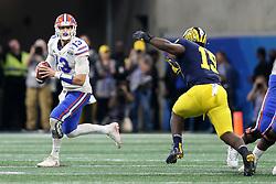 Florida Gators quarterback Feleipe Franks #13 rolls out on a pass play during the Chick-fil-A Peach Bowl, Saturday, December 29, 2018, in Atlanta. (Jason Parkhurst via Abell Images for Chick-fil-A Peach Bowl)